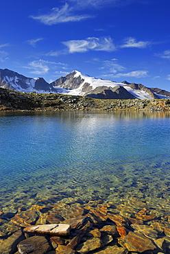 lake Samoarsee with Similaun, ascent to Kreuzspitze from hut Martin-Busch-Huette, Oetztal range, Tyrol, Austria