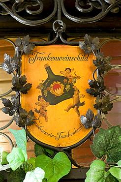 Sign amidst vine leaves, Hotel and Restaurant Loewen, Marktbreit, Franconia, Bavaria, Germany