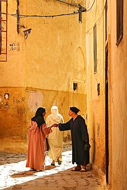 Locals at an alley of Meknes' medina, Meknes, Morocco, Africa