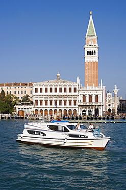 Le Boat Magnifique houseboat cruising past the Campanile Tower and Basilica San Marco, Venice, Veneto, Italy