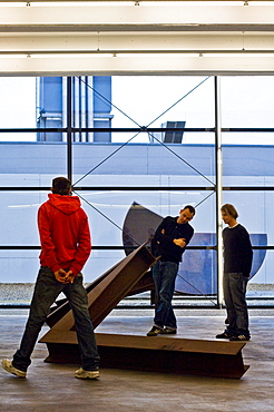 A group of young people looking at a sculpture on the Lechner Museum, Ingolstadt, Bavaria, Germany