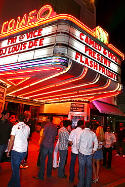 People standing in front of the Cameo Nightclub at night, South Beach, Miami, Florida, USA