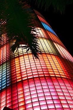 The illuminated China Club neon block tower at night, South Beach, Miami Beach, Florida, USA