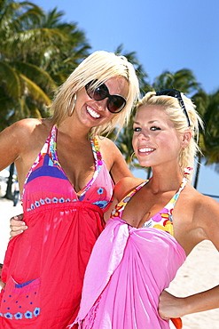 Two laughing blondes in the sunlight, South Beach, Miami Beach, Florida, USA