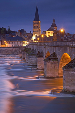 Evening in the old town of La-Charité-sur-Loire, Stone bridge over the Loire river, Church and former monastery Ste Croix Notre Dame, The Way of St. James, Chemins de Saint Jacques, Via Lemovicensis, La-Charité-sur-Loire, Dept. Nievre, Burgundy, France, Europe
