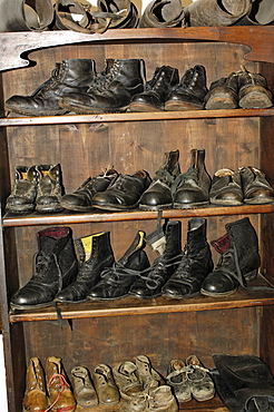 Shoes at the cobblers, South Tyrolean local history museum at Dietenheim, Puster Valley, South Tyrol, Italy