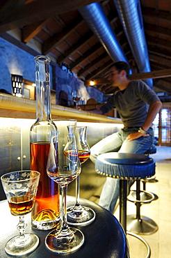 A man sitting in the bar of Hotel Bad Schoergau, Bad Schoergau, Valley Sarntal, South Tyrol, Italy, Europe