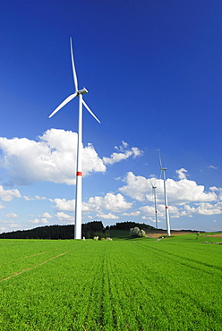 Three wind turbines in meadow, Bavaria, Germany