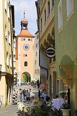 Pavement cafe near bridge tower, Regensburg, Upper Palatinate, Bavaria, Germany
