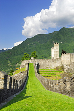 Castle Castelgrande with defence walls, towers Weisser Turm and Schwarzer Turm in UNESCO World Heritage Site Bellinzona, Bellinzona, Ticino, Switzerland