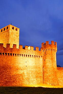 Illuminated castle Castello di Montebello in UNESCO World Heritage Site Bellinzona, Bellinzona, Ticino, Switzerland
