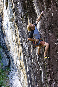 Man climbing on granite wall, Zillertal, Tyrol, Austria