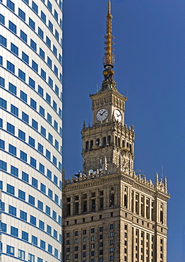 The Palace of Culture and Sciences next to the Zlote Tarasy shopping Complex, Warsaw, Poland, Europe
