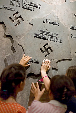 People at an exhibition at the Warsaw Uprising Museum, Warsaw, Poland, Europe