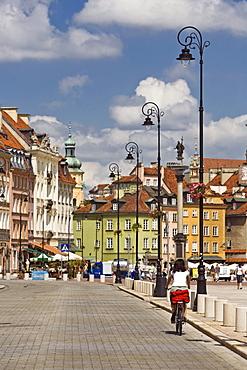 The Krakowskie Przedmiescie Street under clouded sky, Warsaw, Poland, Europe