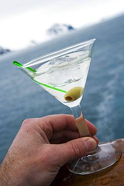 Martini on the rocks with glacial ice aboard cuiseship MS Deutschland (Deilmann Cruises), False Bay, Livingstone Island, South Shetland Islands, Antarctica