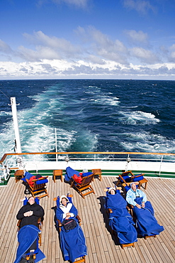 People sunbathing on deck of Cruiseship MS Deutschland (Deilmann Cruises), Drake Passage, South America