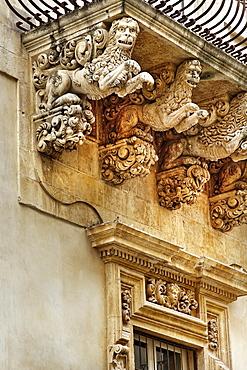 Baroque balcony, Palazzo Nicolai, Noto, Sicily, Italy