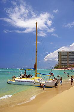 People and catamaran at Waikiki Beach, Honolulu, Oahu, Island, Hawaii, USA, America