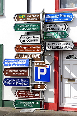 Signposts in the centre of the Ballyvaughan, Ballyvaughan, Galway Bay, County Clare, Ireland