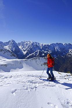 Female backcountry skier ascending, Pyramidenspitze, Eggersgrinn, Zahmer Kaiser, Kaiser range, Tyrol, Austria