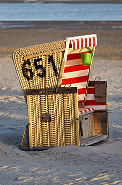 Canopied Beach Chair on the beach, North Sea Spa Resort Langeoog, East Frisia, Lower Saxony, Germany
