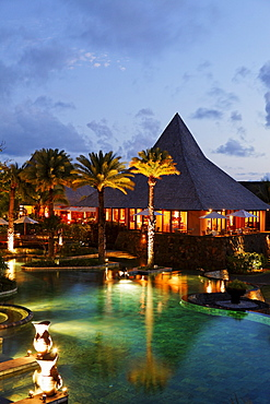 Pool and restaurant at Shanti Maurice Resort in the evening, Souillac, Mauritius, Africa