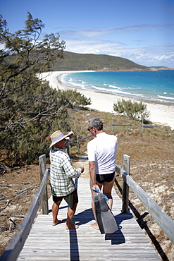 Geoff Mercer, owns a hotel and lives on Great Keppel Island, with tourist on the way to the beach, Great Keppel Island, Great Barrier Reef Marine Park, UNESCO World Heritage Site, Queensland, Australia
