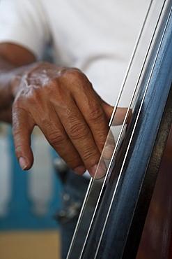 Hand strums on a contrabass, Vinales, Pinar del Rio, Cuba, Caribbean