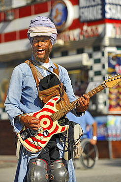 Street musician with guitar, Venice Beach, Los Angeles, California, USA