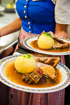 Waitress with roast pork, Weltenburg, Bavaria, Germany, Europe