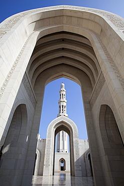 Archway and minaret at Sultan Qaboos Grand Mosque, Muscat, Masqat, Oman, Arabian Peninsula