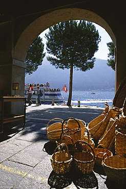 View through an archway towards Lake Lugano, Morcote, Ticino, Switzerland