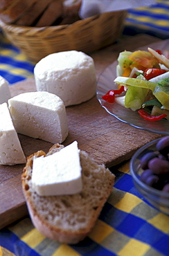 Goat cheese and bread on a table, Serra do Caldeirao, Tavira, Algarve, Portugal, Europe