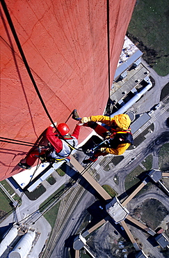 Two workers secured with ropes working on vertical surface, chimney, renovation works, Duernrohr power plant, Zwentendorf an der Donau, Lower Austria
