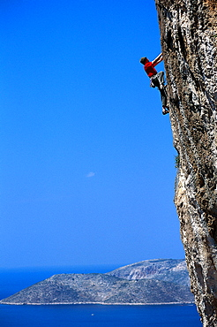 Sepp Hack rock climbing, climbing up a steep rock face, Freeclimbing, Kalymnos, Dodekanes, Greece