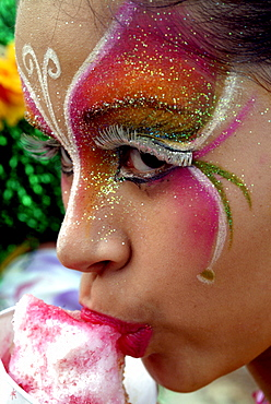 Painted girl eating ice cream, Baranquilla, Colombia, South America