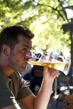 Man drinking Weissbier in Beergarden Hofgarten, Munich, Bavaria, Germany