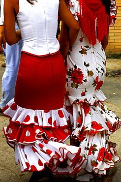 Women wearing Flamenco dresses, Seville, Andalucia, Spain, Europe