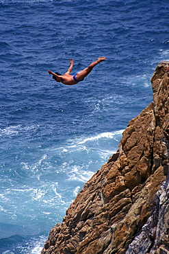 Cliff diver during jump, Acapulco, Guerrero, Mexico, America