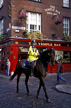 Patrolman on horseback in front of the Temple Bar, Temple Bar District, Dublin, Ireland, Europe