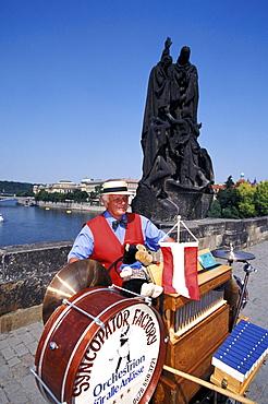 Musician at Charles Bridge in the sunlight, Prague, Czechia, Europe
