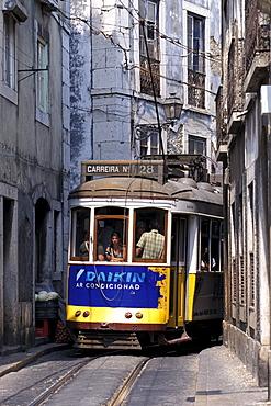 Tram in a narrow alley, Electrico 28, Alfama, Lisbon, Portugal, Europe