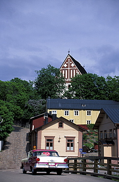 Car in front of historical houses at the old town, Porvoo, Finland, Europe
