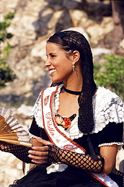 Young women in traditional dress representing different villages at the Wine Festival in Sitges, Costa de Garraf, Spain