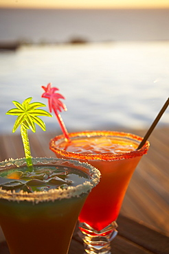 Colourful cocktails at the pool of Hotel Restaurant Le Rayon Vert in the evening, Deshaies, Basse-Terre, Guadeloupe, Caribbean Sea, America