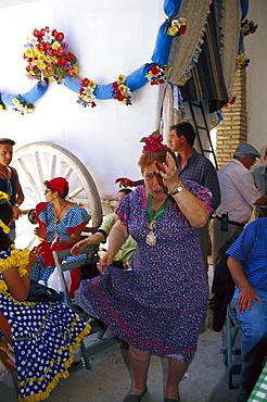 Mature woman dancing Flamenco, El RocÃŒo, Andalusia, Spain