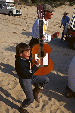 Pilgrim and boy with guitar at national park Donana, El RocÃŒo, Andalusia, Spain, Europe