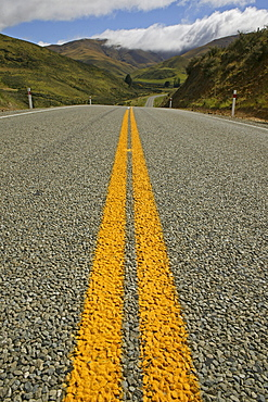 Yellow double medial strip on a country road in Otago, South Island, New Zealand, Oceania
