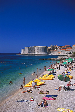 People on the beach in front of the old town of Dubrovnik, Croatia, Europe
